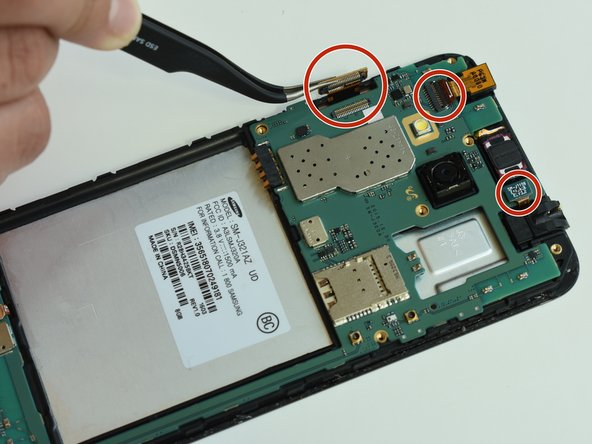 After removing the grey part of the phone, you will need to remove the motherboard by detaching all the chips.