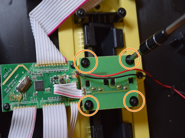Once the Motherboard has been identified, begin unscrewing the Motherboard by using a Phillips Head 0 Screwdriver. There will be two 9 mm Phillips Head screws with, they are located on opposite corners.