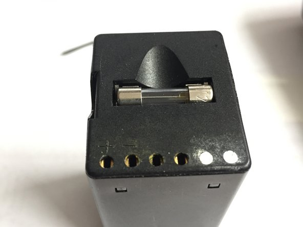 Fill the two unused connectors (from the temp sensor) with hard glue. This prevents users from accidentally using a Rollei Charger N or G, which are not suitable for the battery type and might cause fire or explosion.