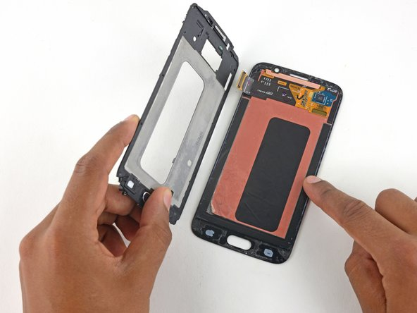 Once you've lifted the frame past 90 degrees, thread the digitizer cable through its hole in the display frame and separate the frame from the display assembly.