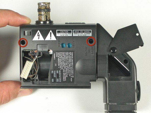 Unscrew the two 7mm ph#0 screws on the underside of the viewfinder assembly.