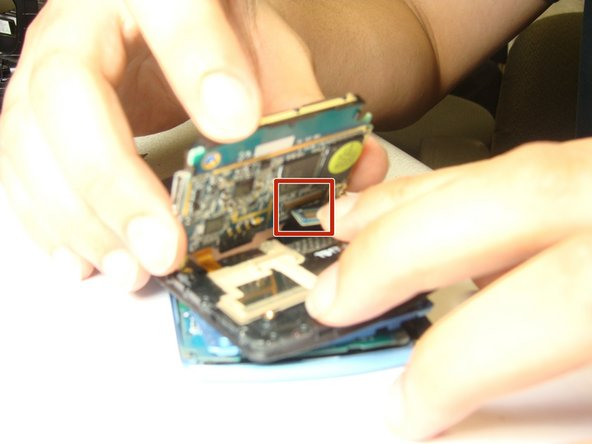 Use hands to remove both phone buses from the linkages, and remove motherboard.