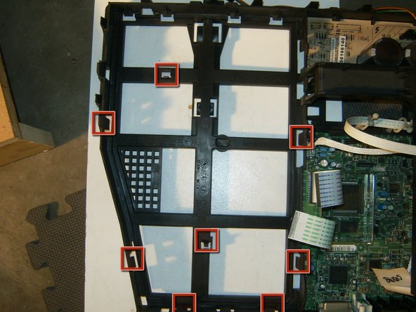 Image 1/2: With the components replaced it is time to reassemble the TV. Here is another look at the plastic chassis with all the clips.