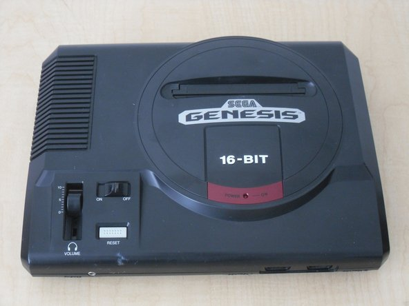 Flip the Sega Genesis upright.