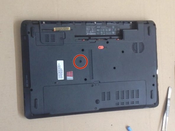 Remove the battery and the DVD drive.
