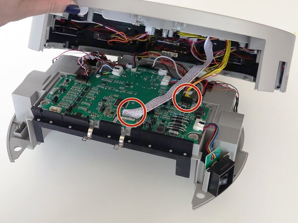 Image 1/3: Remove the two circuit plugs connecting the lid to the mainboard.