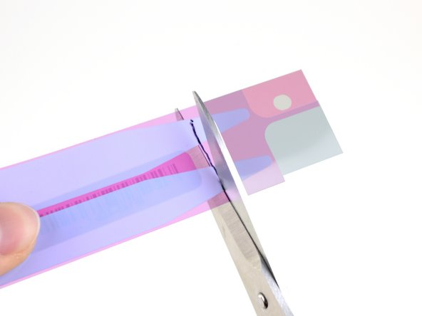 Use a pair of sharp scissors or a razor blade to cut the stretch release adhesive tabs at the marked line.