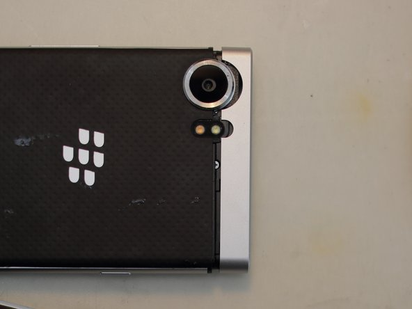 Remove the two Philipps #0 screws that hold in place the top of the phone frame and slide it off.