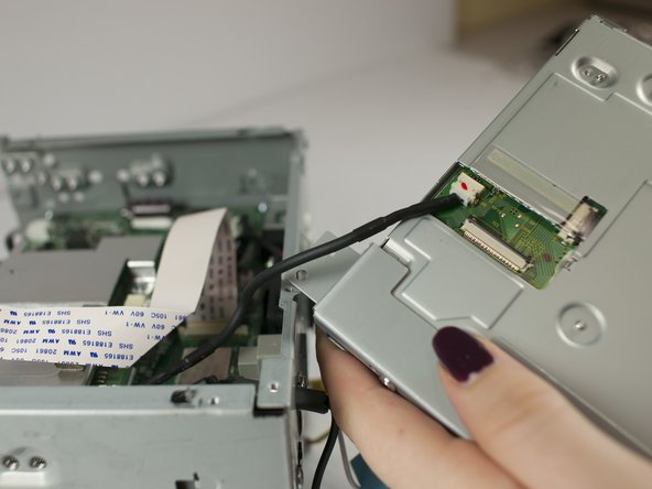 Gently pull to remove the electrical connector from disc drive.
