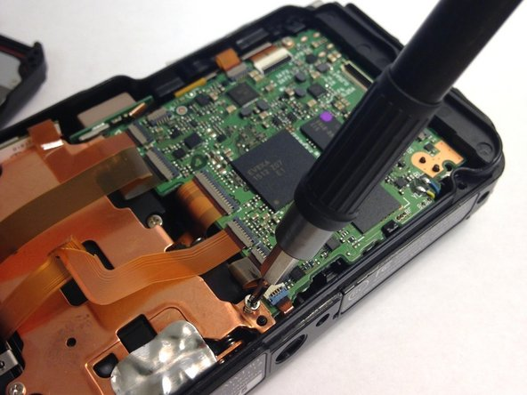 Using a Phillips #000 screwdriver, remove all 8, 4mm screws on the motherboard.