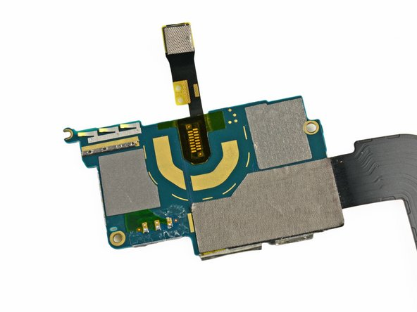 We can't suss out the reason behind the shape of this ribbon cable. Perhaps Apple put it there for sh*ts and wiggles?