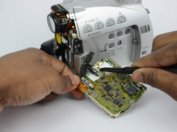 Use tweezers  to remove the wire connections that hold the LCD screen in place.