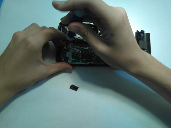 Unscrew the inside screws, and make sure not to damage the circuitry.