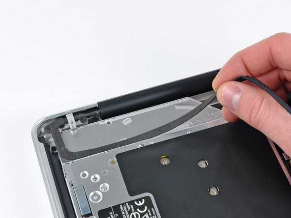 Peel the camera cable off the adhesive securing it to the body of the optical drive.