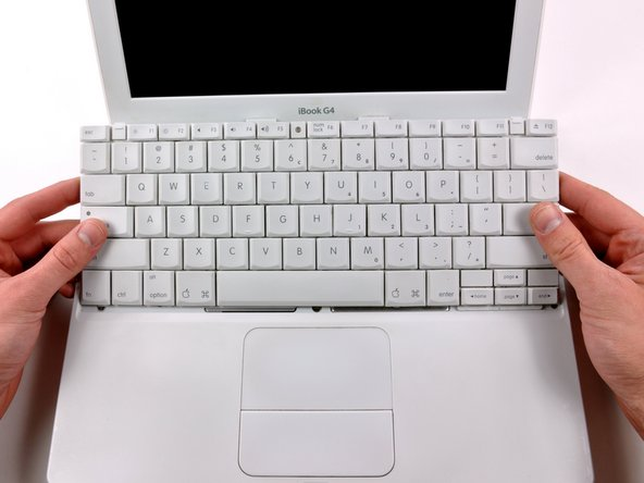 Image 2/2: Flip the keyboard over, away from the screen, and rest it face-down on the trackpad area.