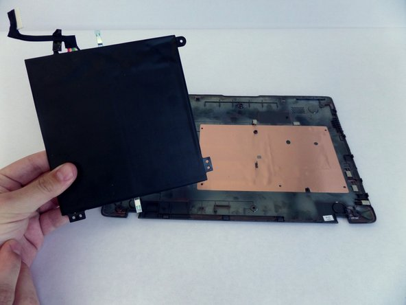 Lift the battery and detach it from the back panel.