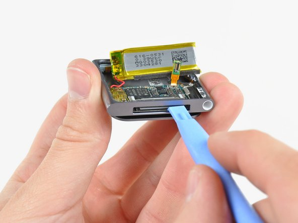 Use your iPod opening tool to gently push the dock connector toward the center of the Nano.