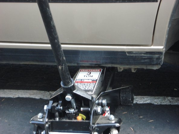 Use hydraulic jack on frame of car to raise car.