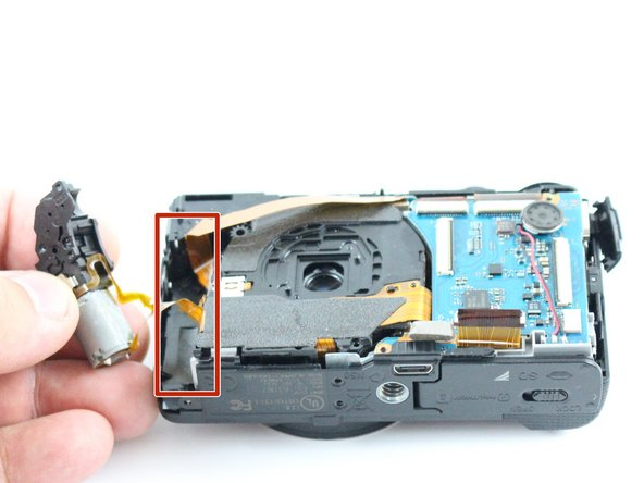 Remove the lens motor by pulling it out of the marked compartment using your fingers.  The motor does not have to be disconnected.