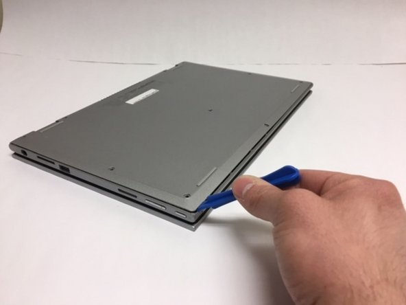 Insert a plastic opening and run it along the edge of the back cover. Do this until the entire back cover can be removed.