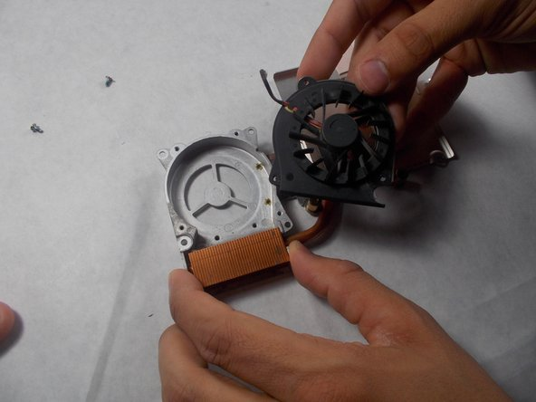 Remove the fan from its metal protective cover.