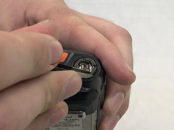 Remove grey nut from base of volume knob by turning it counterclockwise  with a set of tweezers.