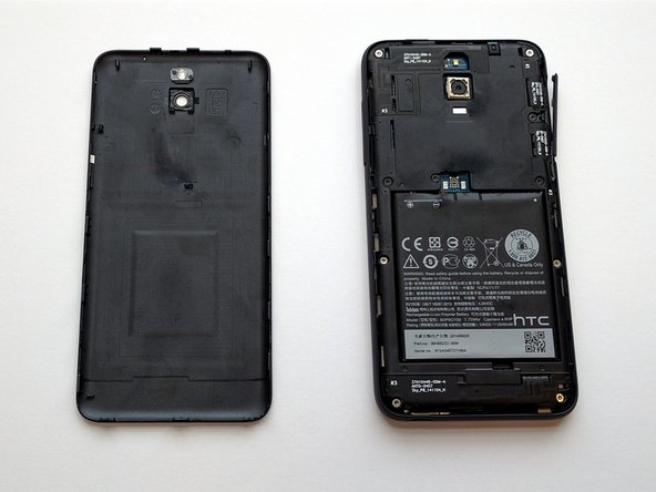 Using plastic opening tool, take off the back cover of the phone.