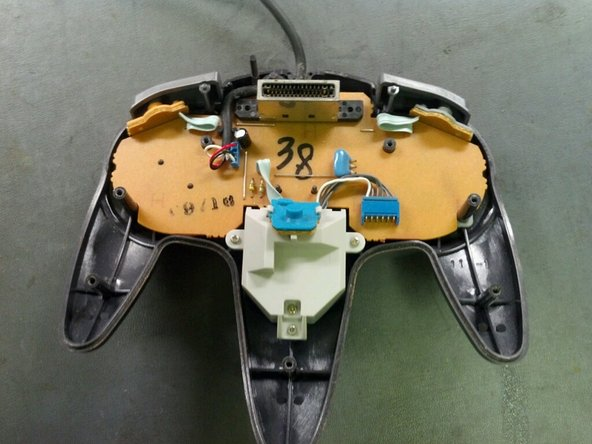 Gently remove the Z-Button membrane and board by sliding them to the left and pulling out of the joystick assembly.