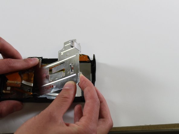 Remove the metal plate covering inside of the LCD screen