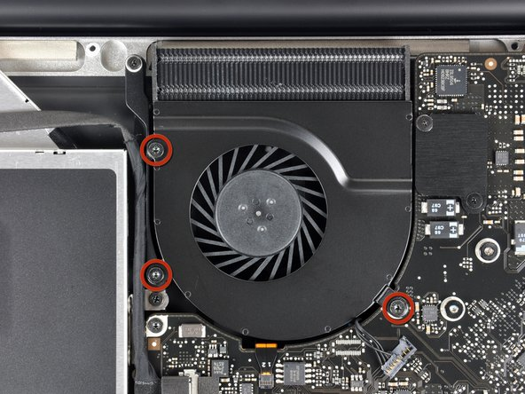 Remove three T6 Torx screws securing the right fan to the logic board and upper case.
