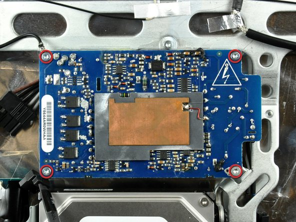 Image 1/2: Remove the 4 Torx T10 screws and gently lift the lefts side up and angle the power supply as shown in the second photo.