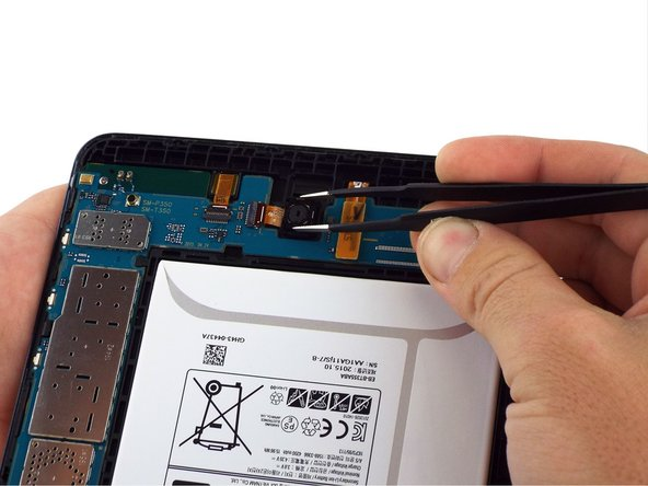 Then use tweezers to gently remove the rear facing camera from the device.