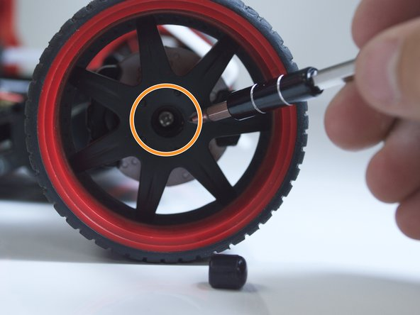Use the #2 Phillips screwdriver to remove the 4mm Phillips #2 screw inside the wheel.