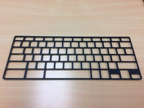 On the bottom of the keyboard frame you will notices there are some plastic notches and hooks that snap into place.