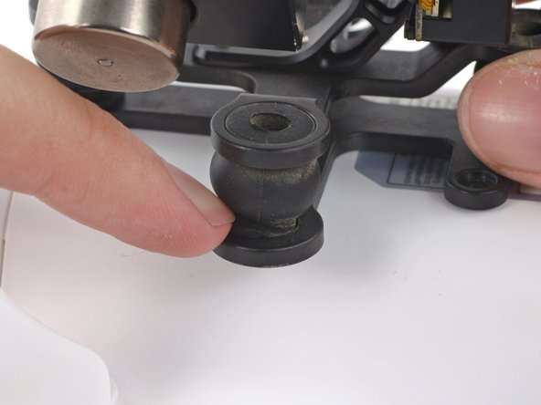 Image 2/3: Pinch two sides of the rubber dampers and press it into the mounting bracket holes.