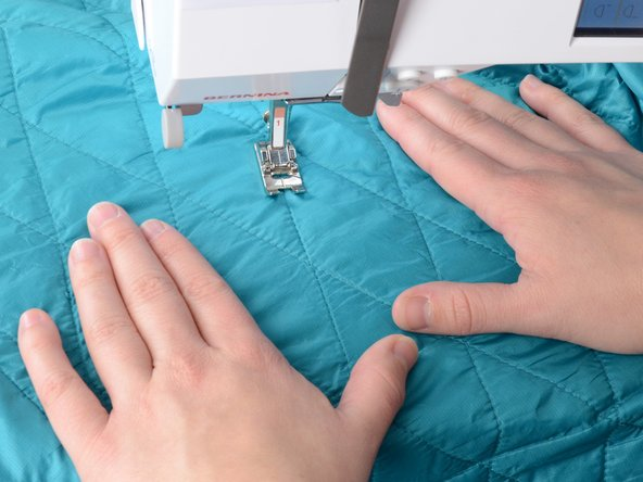 Image 2/2: Be sure that the jacket is unzipped and that you only have one layer of the jacket, including the lining, in the sewing machine. Sewing two layers together will sew the jacket shut.