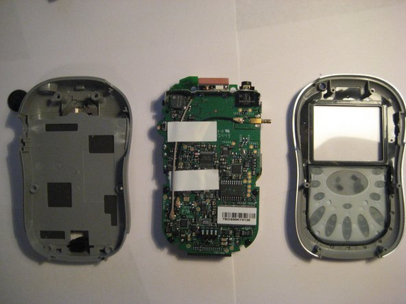 The front plate, back plate, and PCB Logic Board (motherboard) are then free from the device.