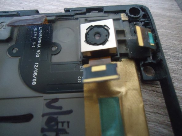 The rear camera is glued to the naked phone. A flat screwdriver and the camera is gone!