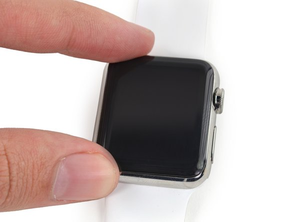 Center the screen over the case and press it down firmly onto the adhesive.