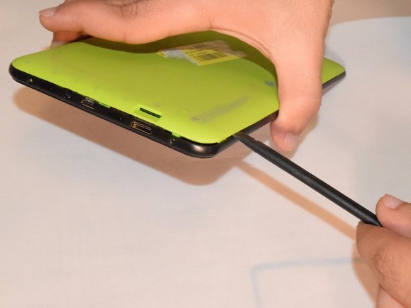 Image 1/2: Carefully separate the front and back plates because the wire that connects the speaker is connected to both the front and back plates.