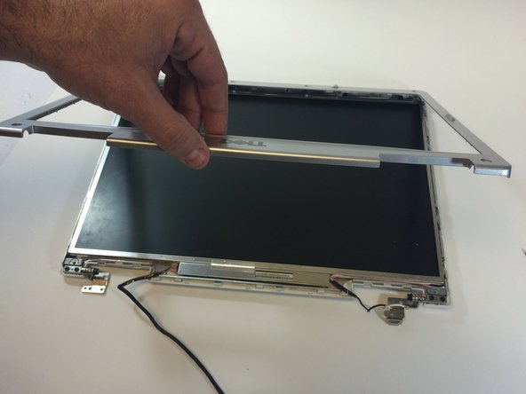 Go completely around the screen, separating the screen holders with the plastic opening tools.