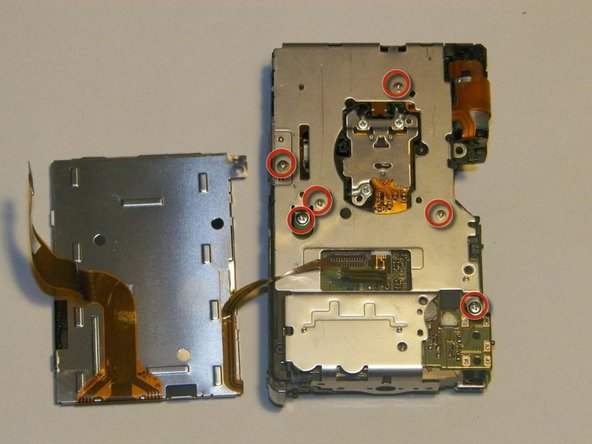 Image 1/1: Remove the screws with the screwdriver.