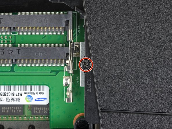 Remove the 5.2 mm Phillips #00 screw securing the optical drive.