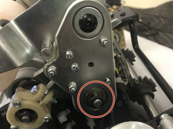 Remove the upper Nut and washer .