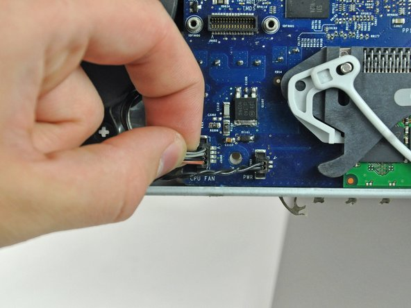 Disconnect the hard drive fan by pulling its connector away from the face of the logic board.