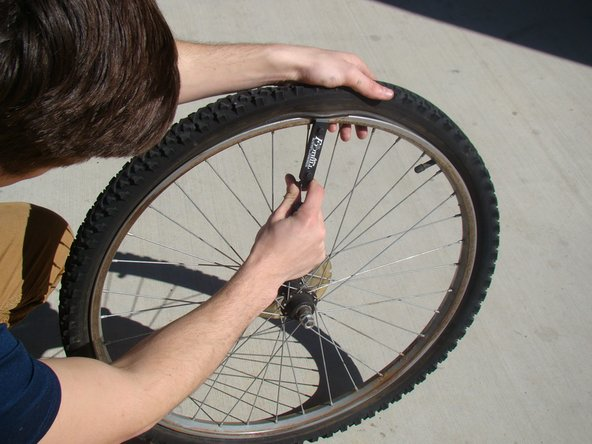 Clip the tire lever to the nearest spoke.