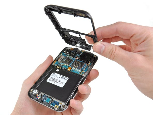Image 1/2: With the plastic framework gone, we get a good look at the Galaxy S 4G's internals. The motherboard is quite compact.