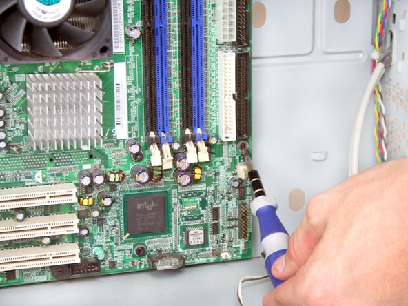 Remove the 8 Torx T15 screws from the motherboard.