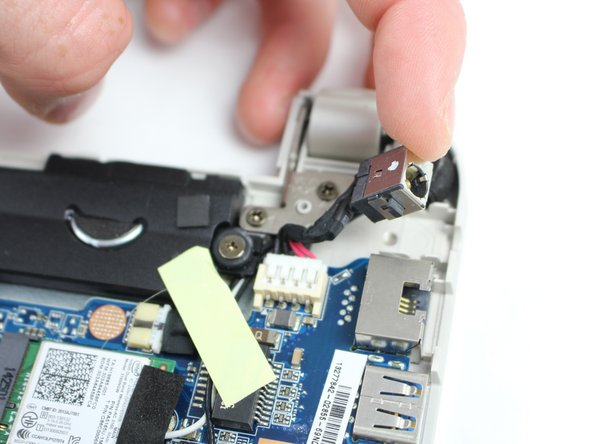 Unplug the charging plug housing from the motherboard.
