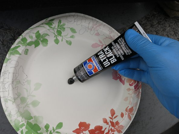 Put a dab of RTV silicone on a disposable plate, or some other clean, non-essential surface.